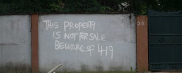 A sign warning that the property isn't for sale